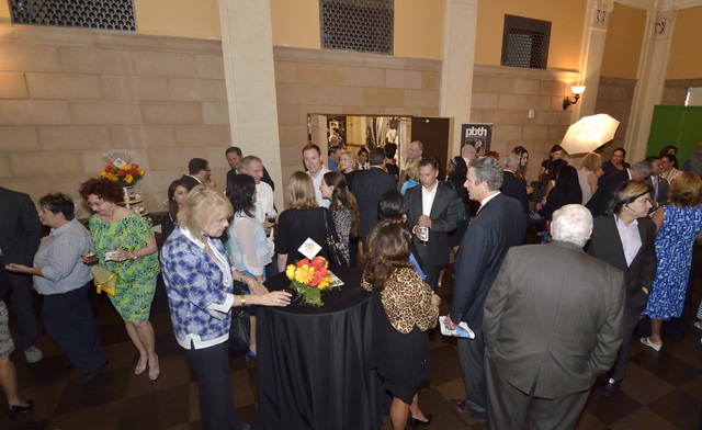 Guests mingle during the 30th anniversary celebration for the Las Vegas Business Press at the Mob Museum at 300 E. Stewart Ave. in Las Vegas on Thursday, June 26, 2014. (Bill Hughes/Las Vegas Revi ...