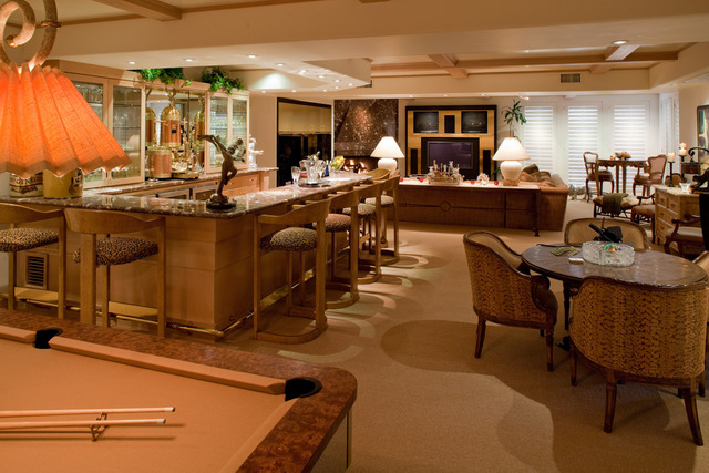 Courtesy photo Gary Primm used hotel quality standards to built the compound in the early 1990s. This game room speaks to his resort-building experience with its bar, poker table, pool table and e ...