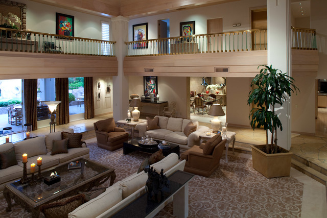 Courtesy photo The three-story, 15,000-square-foot main residence, which is connected by an elevator, is a careful mix of hotel quality amenities and cozy intiment spaces.
