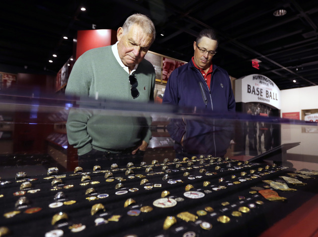 Former Atlanta Braves manager Bobby Cox, left, and former pitcher Greg Maddux look at an exhibit of World Series rings during their orientation visit at the Baseball Hall of Fame on Monday, March  ...