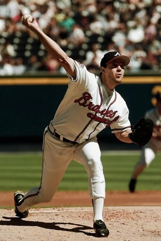 Atlanta Braves starting pitcher Greg Maddux hurls against the Houston Astros in the second inning Tuesday, Sept. 30, 1997 of Game 1 of  the National League Division Series at Turner Field in Atlan ...
