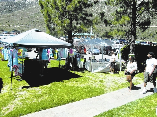 Patrons check out wares at the Mount Charleston Arts and Crafts Show at The Resort on Mount Charleston, 2275 Kyle Canyon Road. This year's event is set from 10 a.m. to 5 p.m. Aug. 9 and 10. (SPECI ...
