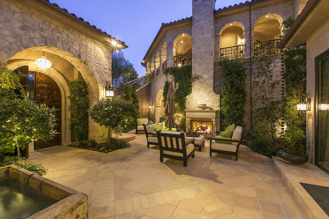 Courtesy photo  The classic Mediterranean-style Italian villa features a courtyard before the entance to the home.