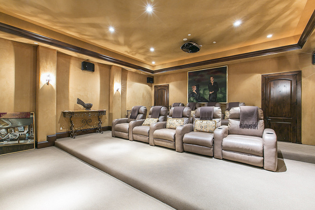 Courtesy photo  A movie theatre is next to the wine cellar. It has a projection screen system that includes 7.1-speaker surround sound and nine cushioned easy chairs.