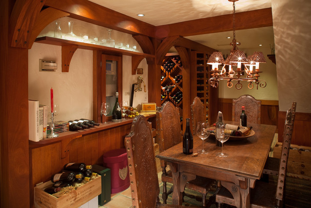 Courtesy photo The 5,000-bottle wine cellar is below the kitchen and accessed by an elevator. It has an a small dining area for wine tasting parites.