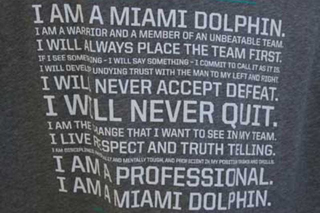 A T-shirt is displayed at the Miami Dolphins NFL football training camp in Davie, Fla., Wednesday, July 30, 2014. The Dolphins, rocked by a bullying scandal last season, are now wearing T-shirts b ...
