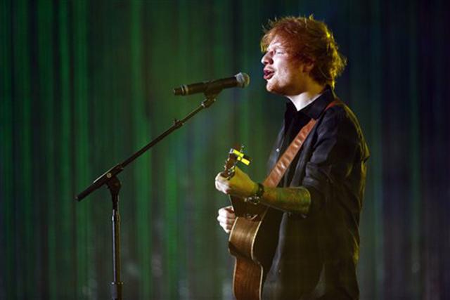 British singer Ed Sheeran performs during an Independence Day celebration, Friday, July 4, 2014, in Philadelphia. (AP Photo/Matt Rourke)