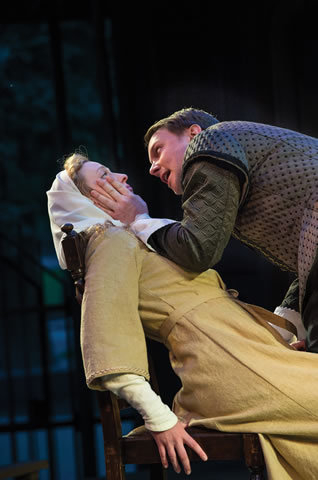 """The virtuous, virginal Isabella (Erika Haaland), left, finds herself menaced by the powerful Angelo (Steve Wojtas) in Shakespeare's dark """"Measure for Measure.""""  (Courtesy, Karl Hugh)"""