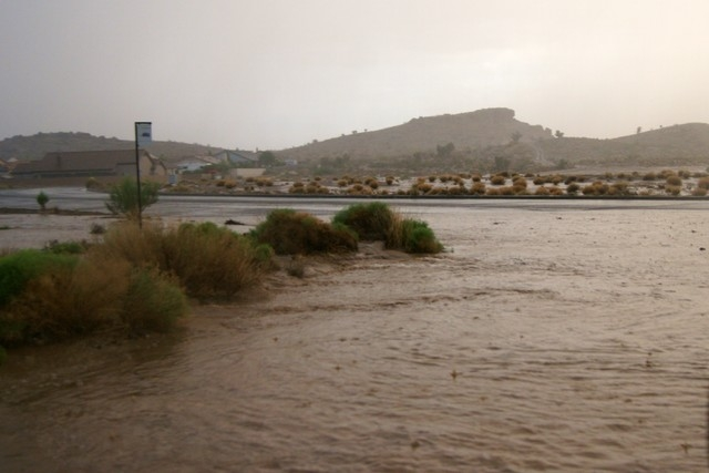Flooding fills the street along Mission Blvd. in Kingman, Ariz. on Monday, July 14, 2014 during a fierce monsoon season thunderstorm. The Kingman Fire Department and Northern Arizona Consolidated  ...