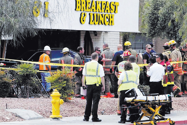 Las Vegas police and firefighters gather at the scene of the crash Monday at the Egg & I on 4533 W. Sahara Ave. (Jerry Henkel/Las Vegas Review-Journal)