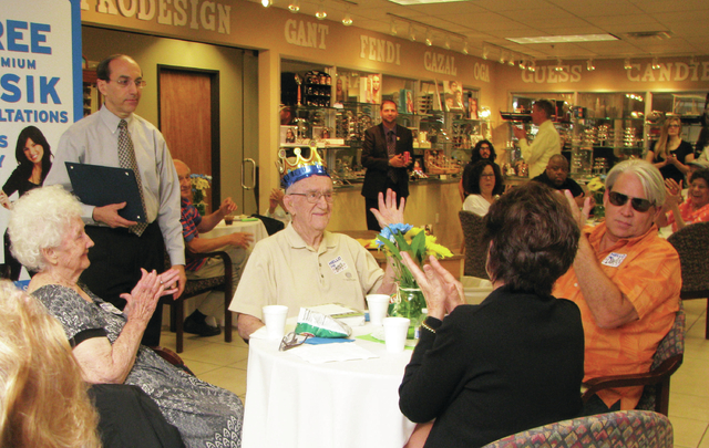 Friends, family, Dr. Emil Stein and several of his patients help Horace T. Ayres celebrate his 100th birthday on June 26 at Nevada Eye Care. (F. Andrew Taylor/View)