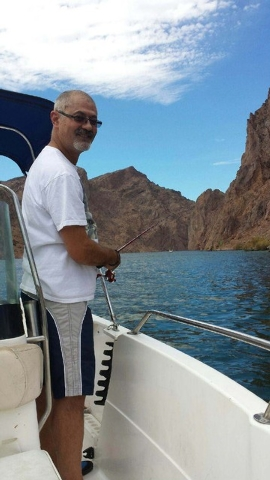 Jorge Luna, 53, on his rental boat last Sunday before he leaped off to go swimming. (Courtesy Photo)