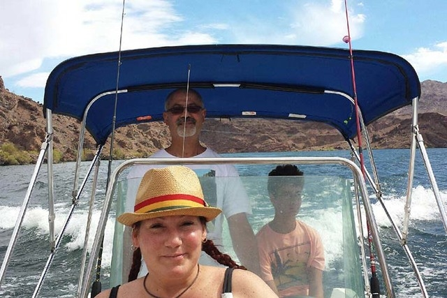 Jorge Luna, 53, with his girlfriend, Tonja Sweeney, and her nephew, Cameron, on his rental boat last Sunday before he leaped off to go swimming. (Courtesy Photo)
