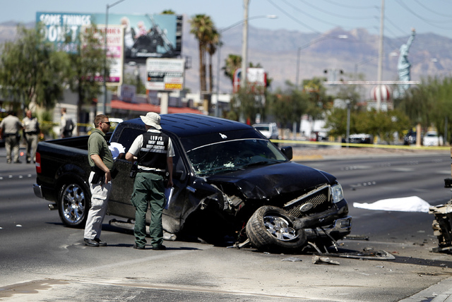 A body lays on the ground on the westbound side of Sahara Avenue near Valley View Boulevard in Las Vegas on Sunday, July 20, 2014. Two cars were involved in a wreck that resulted in the fatal acci ...