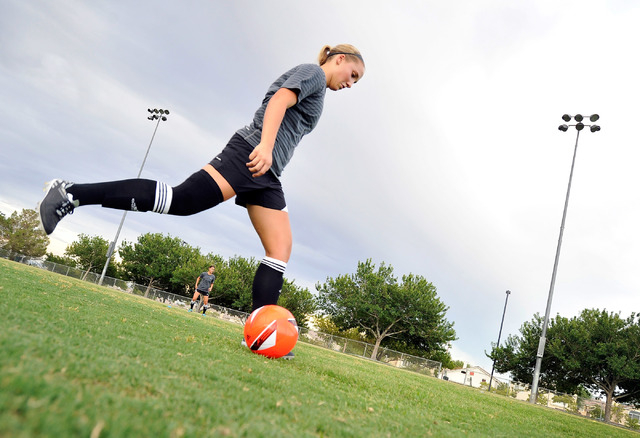 Avery Jacobsen, 15, kicks the ball during her club soccer practice at Crossing Park on Monday, July 7, 2014. Jacobsen is returning to the soccer field after suffering a knee injury. (David Becker/ ...