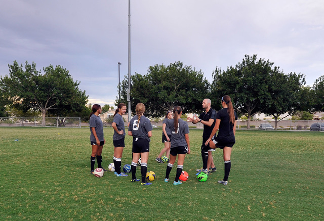 Las Vegas 99 Girls head coach, Danny Stone, 2nd right, works with his team during their club soccer practice at Crossing Park on Monday, July 7, 2014. (David Becker/Las Vegas Review-Journal)