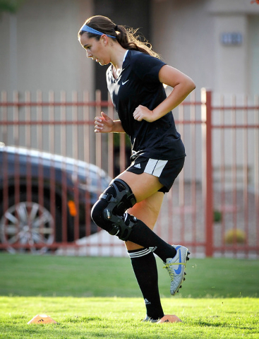Jaydyn Nogues warms up with some dynamic warm up drills during her club soccer practice at Crossing Park on Monday, July 7, 2014. Nogues is returning to the soccer field after suffering a knee inj ...