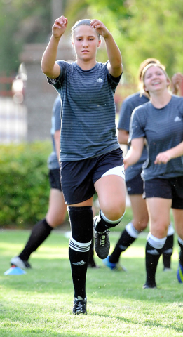 Avery Jacobsen, 15, warms up with some dynamic warm up drills during her club soccer practice at Crossing Park on Monday, July 7, 2014. Jacobsen is returning to the soccer field after suffering a  ...