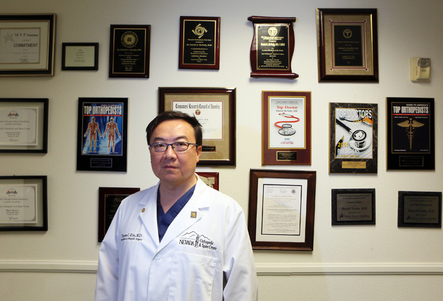 Dr. Thomas Kim stands in a hallway at Nevada Orthopedic and Spine Center Wednesday, July 9, 2014, in Las Vegas. Kim performs surgery on young athletes with a torn anterior cruciate ligament (ACL). ...