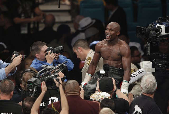 Floyd Mayweather Jr. celebrates after defeating Marcos Maidana in their welterweight title bout at the MGM Grand in Las Vegas Saturday, May 3, 2014. Mayweather has announced that he will fight Mai ...
