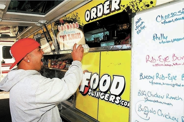A man orders from a food truck. (File Photo)