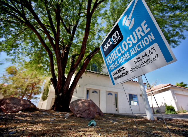 JEFF SCHEID/LAS VEGAS REVIEW-JOURNAL A foreclosed home at 10069 Cambridge Blue Avenue is shown on June 18, 2011.