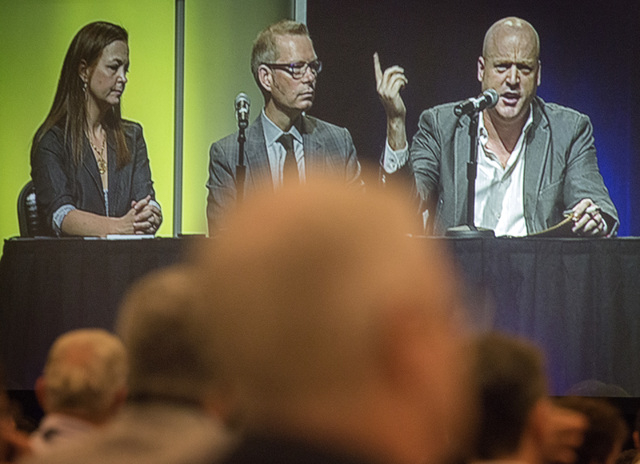 A video screen showing speakers Jenny Beth Martin, left, co-founder and national coordinator of the Tea Party Patriots, Matt Kibbe, president and CEO of FreedomWorks, and Radley Balko, a journalis ...