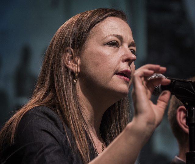 """Jenny Beth Martin, left, co-founder and national coordinator of the Tea Party Patriots, speaks during panel discussion entitled """"NSA, TSA, IRS: Are Big Brother & the Thought Police Here?&quot ..."""