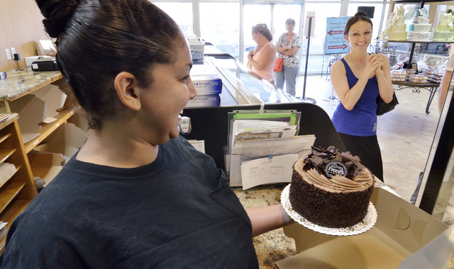 Cashier Tamra Ramirez, left, boxes a dessert cake for Timea Molnar at Freed's Bakery at 9815 S. Eastern Ave. in Las Vegas on Thursday, July 3, 2014. (Bill Hughes/Las Vegas Review-Journal)