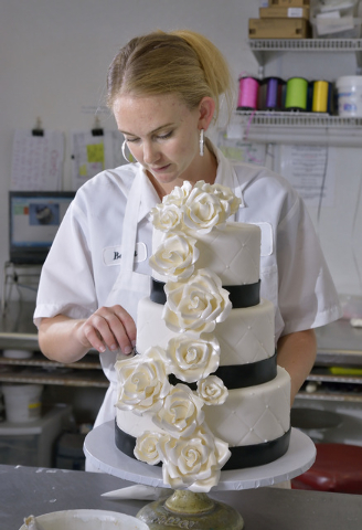 Barret Carpenter works on a wedding cake at Freed's Bakery at 9815 S. Eastern Ave. in Las Vegas on Thursday, July 3, 2014. (Bill Hughes/Las Vegas Review-Journal)
