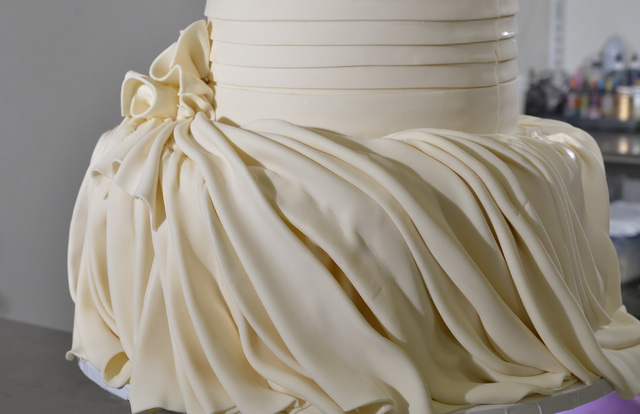 A wedding cake being made to mimic the folds in the bride's dress is shown at Freed's Bakery at 9815 S. Eastern Ave. in Las Vegas on Thursday, July 3, 2014. (Bill Hughes/Las Vegas Review-Journal)