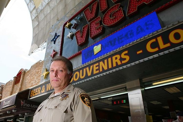 Metro Police Capt. Shawn Andersen, (cq) of Downtown Area Command that polices Fremont Street Experience, stands outside a gift shop that sells liquor at Fremont Street Experience Thursday, July 17 ...