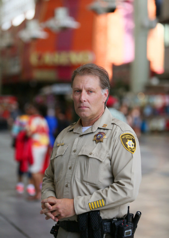 Metro Police Capt. Shawn Andersen, (cq) of Downtown Area Command that polices Fremont Street Experience, stands under the canopy at Fremont Street Experience Thursday, July 17, 2014, in Las Vegas. ...