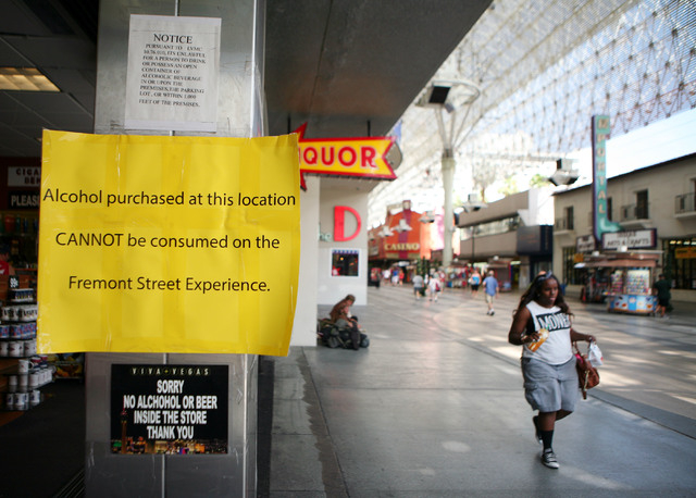 Signs are posted on the entrance to a gift shop that sells liquor at Fremont Street Experience Thursday, July 17, 2014, in Las Vegas.  A series of liquor ordinances are in effect regulating alcoho ...