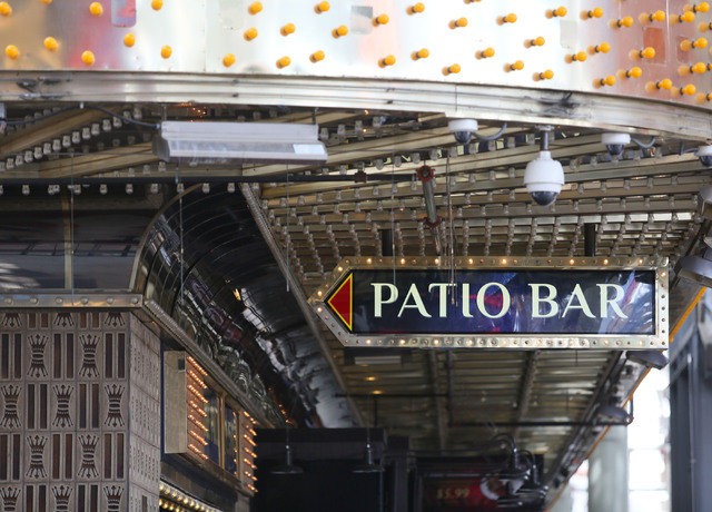 A sign advertises a patio bar at the Four Queens on Fremont Street Experience Thursday, July 17, 2014, in Las Vegas.  A series of liquor ordinances are in effect regulating alcohol carrying and co ...