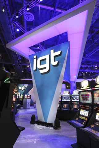 The new logo is seen at the IGT booth at the G2E convention in the Sands Expo in Las Vegas, Monday, Sept. 23, 2013. G2E opens on Tuesday, Sept. 24, 2013. (Jerry Henkel/Las Vegas Review-Journal)