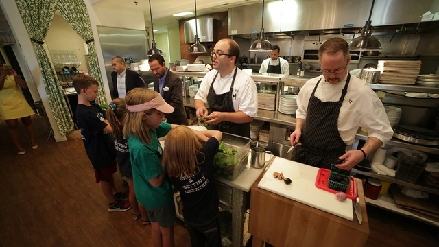 Honey Salt chefs Brett Uniss and Joe Zanelli used green beans, lettuce, figs and other raw vegetables from student gardens throughout the Las Vegas Valley during a June 30 demonstration at the res ...