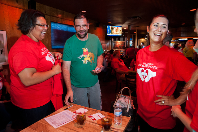 Volunteer Rainy Williams, left, enjoys a laugh with donors Matt Mastalski and Tannia Suarez during the National Gay Blood Drive held at the Blue Ox Tavern at 5825 W. Sahara Ave. in Las Vegas on Fr ...