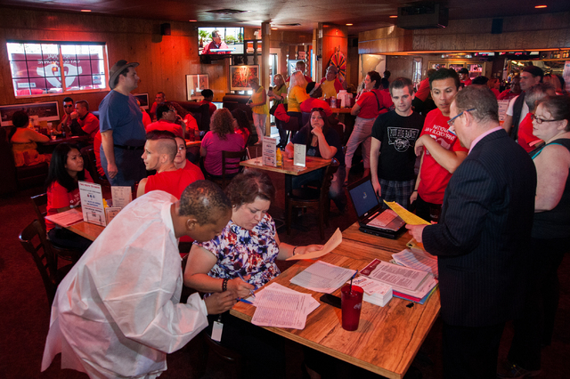 Volunteers and donors conjugate during the National Gay Blood Drive held at the Blue Ox Tavern at 5825 W. Sahara Ave. in Las Vegas on Friday, July 11, 2014. (Martin S. Fuentes/Las Vegas Review-Jou ...