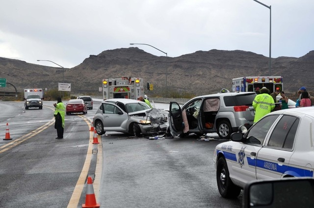 The scene of a head-on collision north of Kingman, Ariz., blocks the roadway on Sunday. A Golden Valley, Ariz., woman was killed in the crash. (Courtesy, Butch Meriwether)