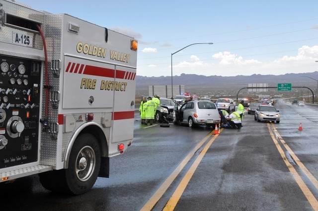 Fire and emergency response crews work at the scene of a crash on Sunday in northwestern Arizona, just north of Kingman. A woman from Golden Valley, Ariz., died in the crash. (Courtesy, Butch Meri ...