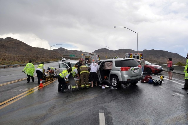 Emergency response crews help victims of a Sunday crash in northwestern Arizona just north of Kingman. A woman from Golden Valley, Ariz., died in the crash. (Courtesy, Butch Meriwether)