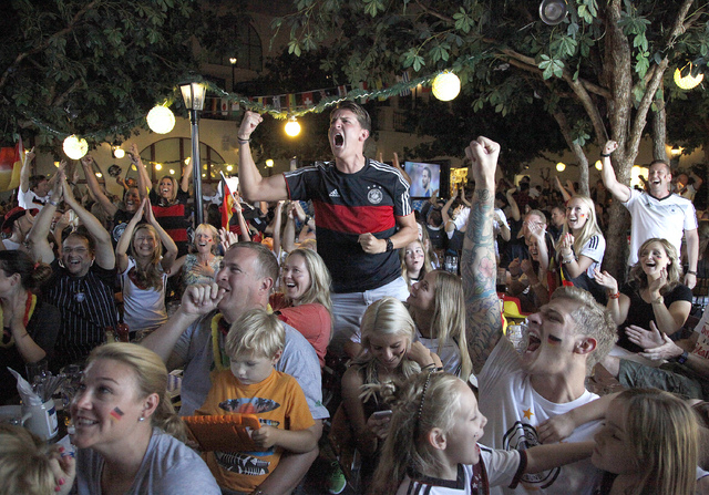 Germany fans react during the viewing of the World Cup Final between Germany and Argentina at the Hofbräuhaus in Las Vegas on Sunday, July 13, 2014. Germany scored in extra time to win the 2014 W ...