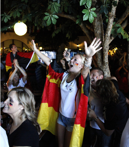 Marie Kamien, of Frankfurt, Germany, reacts during the viewing of the World Cup Final between Germany and Argentina at the Hofbräuhaus in Las Vegas on Sunday, July 13, 2014. Germany scored in ext ...