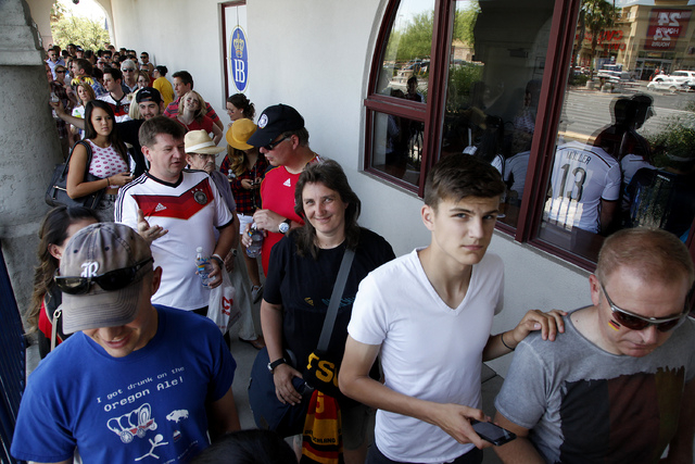 Fans wait in line to view the World Cup Final between Germany and Argentina at the Hofbräuhaus in Las Vegas on Sunday, July 13, 2014. Germany scored in extra time to win the 2014 World Cup. (Just ...