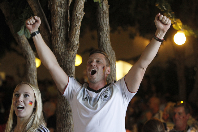 Torben Scholer, center, and Marie Kamien react during the viewing of the World Cup Final between Germany and Argentina at the Hofbräuhaus in Las Vegas on Sunday, July 13, 2014. Germany scored in  ...