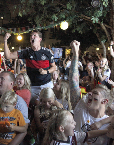Germany fans react during the viewing of the World Cup Final between Germany and Argentina at the Hofbräuhaus in Las Vegas on Sunday, July 13, 2014. Germany scored in extra time to win the 20 ...