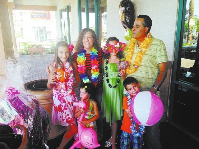 Emilee, who is 9 and lives with congenital anomalies, smiles at Pink Box Doughnuts, 7531 W. Lake Mead Blvd., June 8 after learning good news: her wish to visit Hawaii was being granted, courtesy o ...