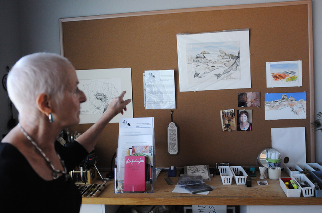 Artist Eileen Raucher-Sutton, who has professionally painted artwork since 1970 in New York, shows a board with her work in progress during a tour of her home studio in Henderson, June 25. (Erik V ...