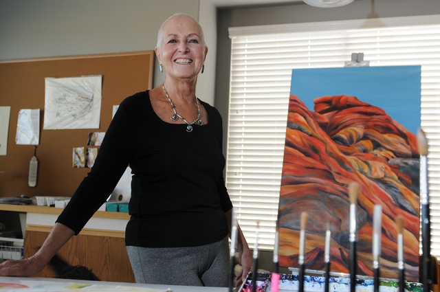 Eileen Raucher-Sutton, photographed in her Henderson home studio June 25, is slated to show about 15 of her paintings through Sept. 30 at the Sun City MacDonald Ranch Community Center, 2020 W. Hor ...